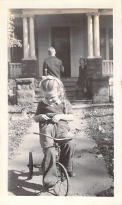15 Oct 1944 Ruth Askew on trike, Don in background