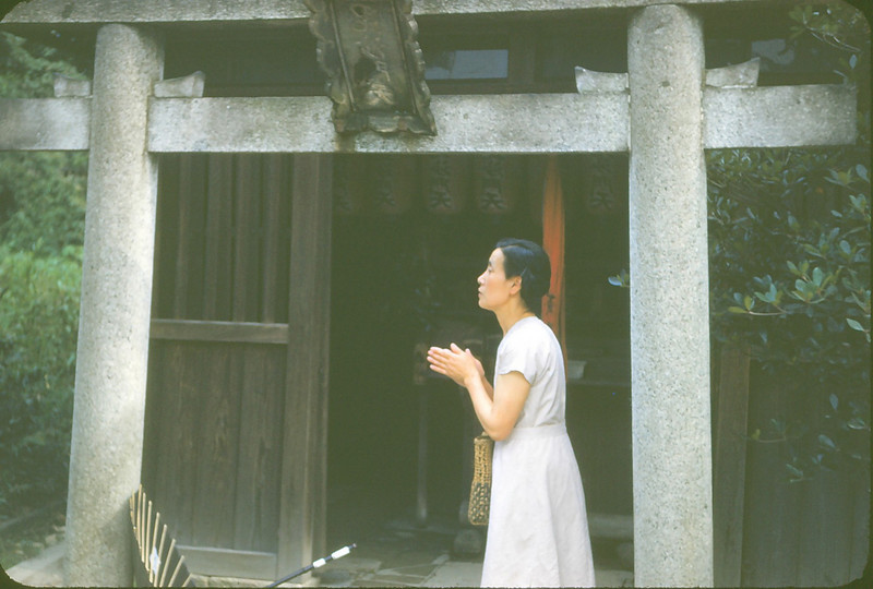 Woman praying at shrine