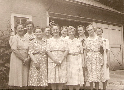 That's my Grandmother Clara Josvanger Aspenson in the middle front.  Other than her I'm not sure if these are relatives or women from church?