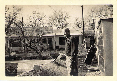 Joseph Edwards behind his Sandy Ranch house
