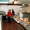 Judy, Rose, Sue and Janelle keep the tables supplied with food