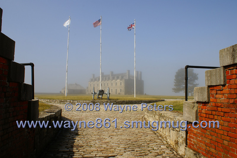 Fort Niagara, the flags and French Castle seen through the Sally Port.