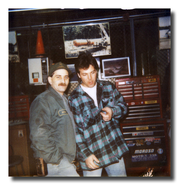 Mike Hall & René Dumont at the UPS maintenance shop, around 1995.