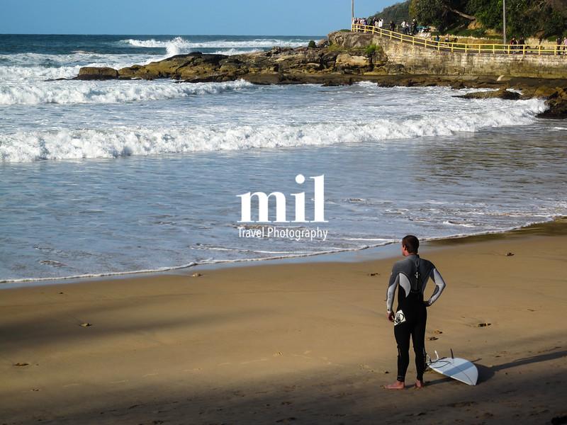 Surfer on the beach in Manly, Sydney, Australia