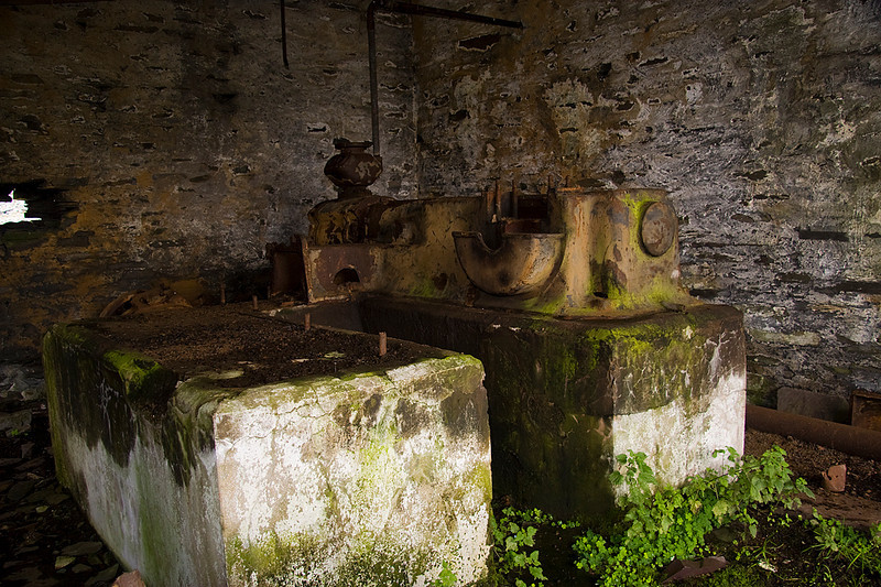 In one of the sheds are the remains of a compressor.   Compressed air was used to power the drills and there were several in the quarry