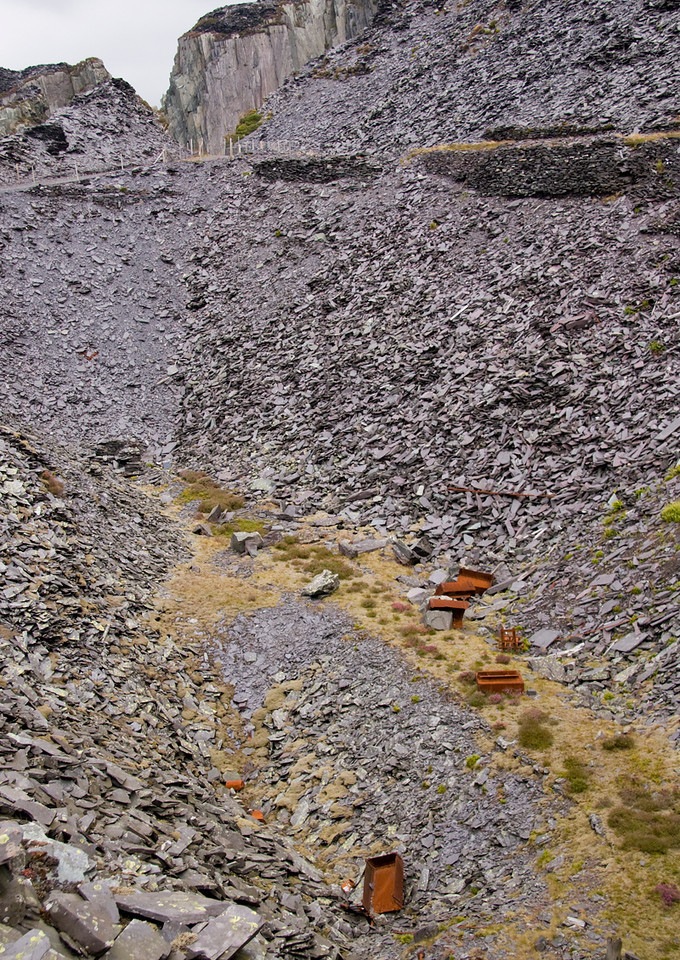 The abandoned waggons again - the road emerging from the gap in the slate heaps is the access road from the village tramway and mills levels.