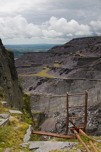 Ther are still many fixed ladders around the quarry - looking across the Garrett Quarry, the levels are - from the bottom Penrhydd; Penrhydd Bach; Twyll Dwndwr, Abasynia and Tophet.   Look carefully and you can see some climbers and in the very far distance is Parys mountain on Anglesey.