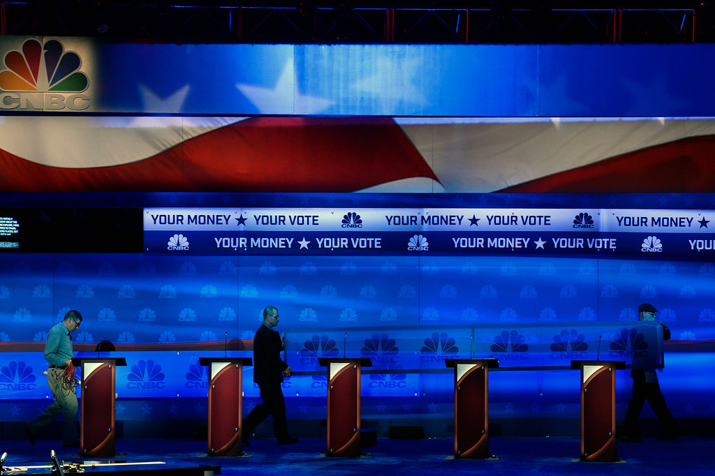 . BOULDER, CO - OCTOBER 27: Crew members bring in a large sign on the debate stage in preparation for the CNBC Republican Presidential Debate at Coors Events Center on the University of Colorado campus in Boulder, Colorado on October 27, 2015.  There will be two debates between 14 different candidates.  The first debate will include Lindsey Graham Bobby Jindal, George Pataki, and Rick Santorum.  The second debate will include Jeb Bush, Ben Carson, Chris Christie, Ted Cruz, Carly Florin, Mike Huckabee, John Kasich, Rand Paul, Marco Rubio and Donald Trump. (Photo by Helen H. Richardson/The Denver Post)