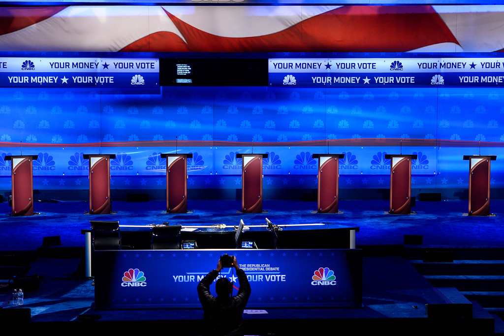 . BOULDER, CO - OCTOBER 27: A photographer takes photographs of the stage that is being prepared for the for the CNBC Republican Presidential Debate at Coors Events Center on the University of Colorado campus in Boulder, Colorado on October 27, 2015.  There will be two debates between 14 different candidates.  The first debate will include Lindsey Graham Bobby Jindal, George Pataki, and Rick Santorum.  The second debate will include Jeb Bush, Ben Carson, Chris Christie, Ted Cruz, Carly Florin, Mike Huckabee, John Kasich, Rand Paul, Marco Rubio and Donald Trump. (Photo by Helen H. Richardson/The Denver Post)