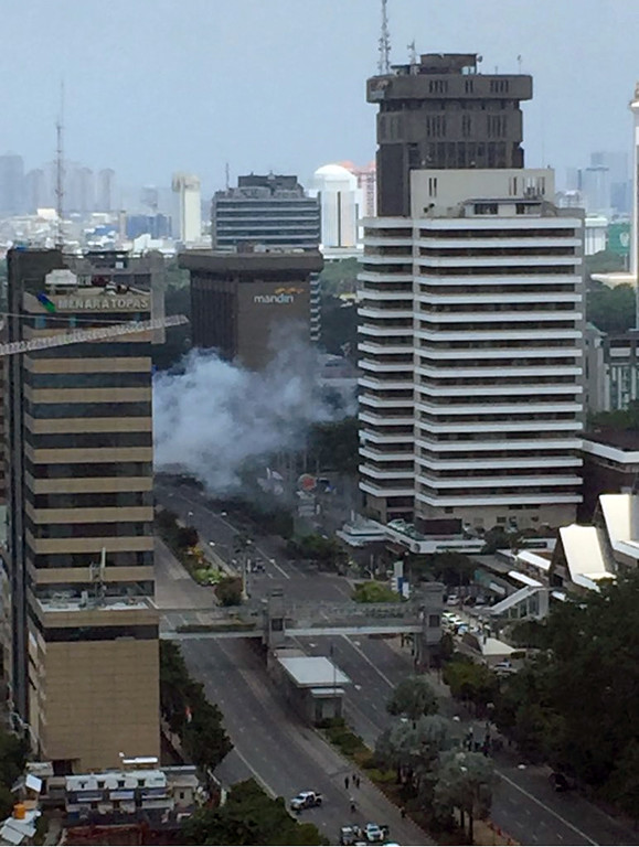 . Smoke billows from an explosion in Jakarta, Indonesia, Thursday, Jan. 14, 2016. Suicide bombers exploded themselves in downtown Jakarta on Thursday while gunmen attacked a police post nearby, a witness told The Associated Press. Local television reported more explosions in other parts of the city. (Christian Hubel via AP) MANDATORY CREDIT