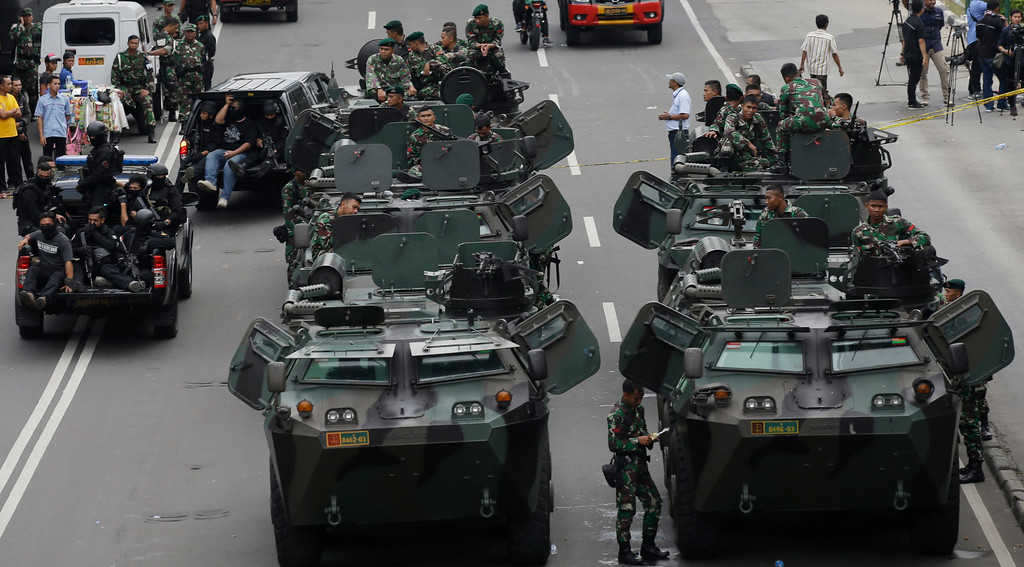 . Indonesian soldiers man armored vehicles as they guard near the site where an attack occurred in Jakarta, Indonesia Thursday, Jan. 14, 2016. Attackers set off explosions at a Starbucks cafe in a bustling shopping area in Indonesia\'s capital and waged gunbattles with police Thursday, leaving bodies in the streets as office workers watched in terror from high-rise buildings. (AP Photo/Achmad Ibrahim)