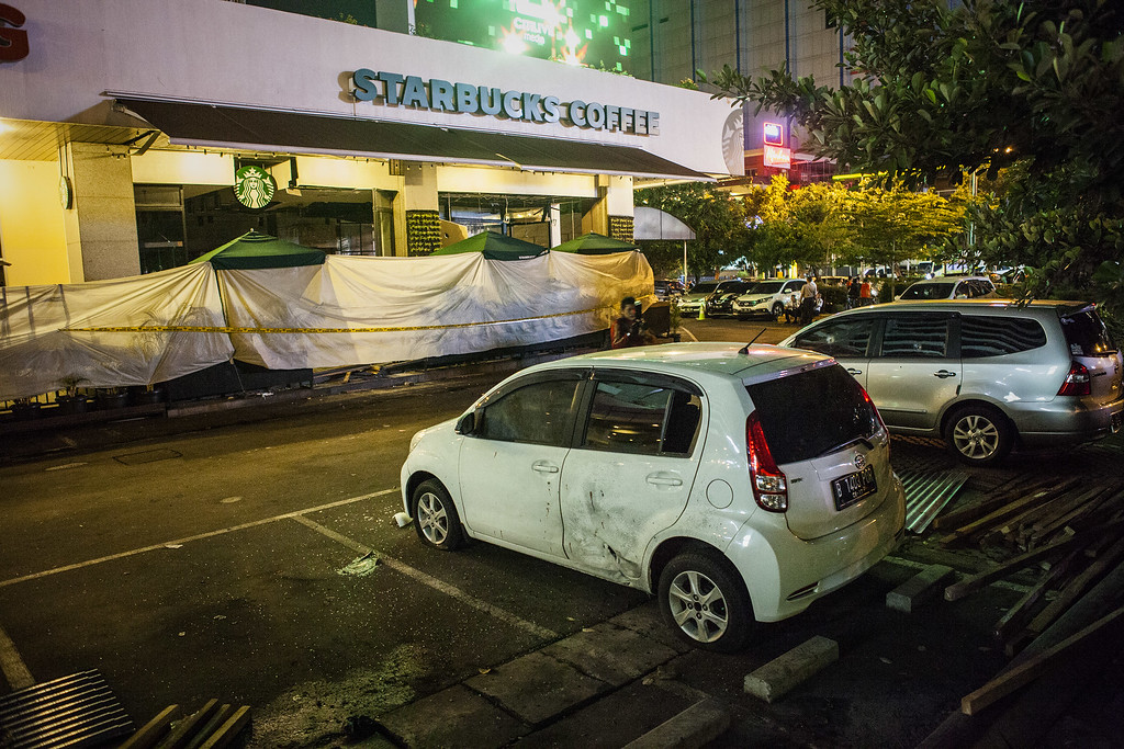 . A view of the blast site outside Starbucks after a series of explosions hit the Indonesia capital on January 14, 2016 in Jakarta, Indonesia. Reports of explosions and gunshots in the centre of the Indonesian capital, including outside the United Nations building and in the front of the Sarinah shopping mall, an area with many luxury hotels, embassies and offices.  (Photo by Oscar Siagian/Getty Images)