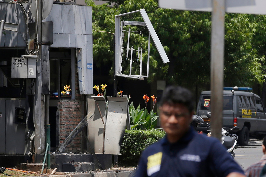 . Indonesia Police make line near one of location bomb in Jakarta, Indonesia, Thursday, Jan. 14, 2016. Suicide bombers exploded themselves in downtown Jakarta on Thursday while gunmen attacked a police post nearby, a witness told The Associated Press. Local television reported more explosions in other parts of the city. (AP Photo/Achmad Ibrahim)