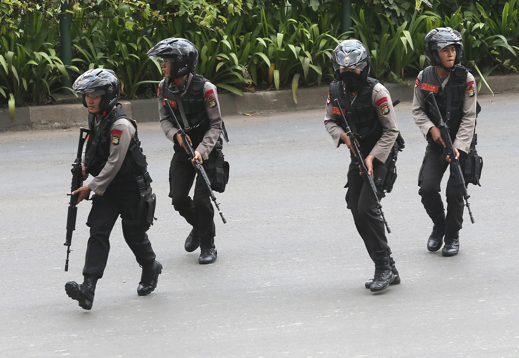 . Police officers rush to take their position at the site of an attack in Jakarta, Indonesia Thursday, Jan. 14, 2016. Attackers set off explosions at a Starbucks cafe in a bustling shopping area in Indonesia\'s capital and waged gunbattles with police Thursday, leaving bodies in the streets as office workers watched in terror from high-rise buildings. (AP Photo/Tatan Syuflana)