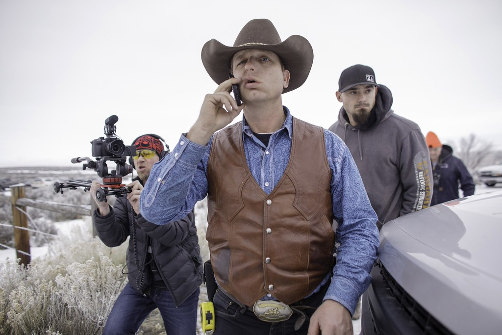 . Ryan Bundy speaks on his phone at the occupied Malheur National Wildlife Refuge on the sixth day of the occupation of the federal building in Burns, Oregon on January 7, 2016. The leader of a small group of armed activists who have occupied a remote wildlife refuge in Oregon hinted on Wednesday that the standoff may be nearing its end. AFP PHOTO / ROB KERRROB KERR/AFP/Getty Images
