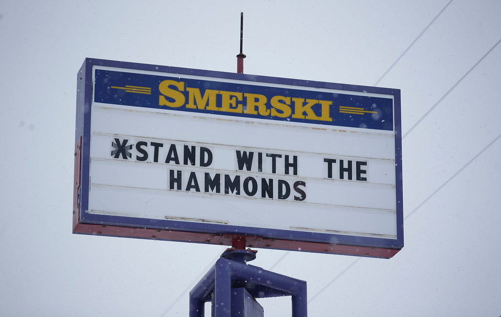 . A sign shows support for the Hammonds Tuesday, Jan. 5, 2016, in Burns, Ore. A group calling itself Citizens for Constitutional Freedom said it wants an inquiry into whether the government is forcing ranchers off their land after Dwight Hammond and his son, Steven, reported back to prison Monday. Ammon Bundy said the group felt it had the support of the local community. (AP Photo/Rick Bowmer)