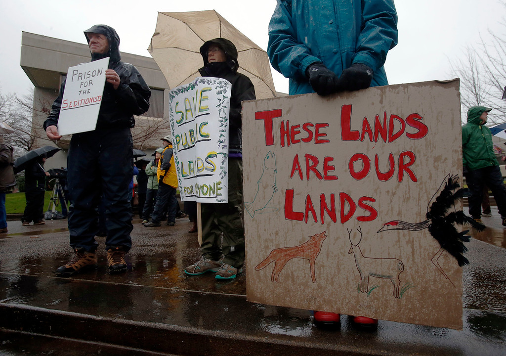 . Protesters rally against the occupation of the Malheur National Wildlife Refuge by Ammon Bundy and his armed followers, while at the Federal Building in Eugene, Ore., Tuesday, Jan. 19, 2016. With the armed takeover of the national wildlife refuge in southeastern Oregon in its third week, Bundy and his armed group are still trying to muster up broad community support, so far without much luck. (Andy Nelson/The Register-Guard via AP) MANDATORY CREDIT
