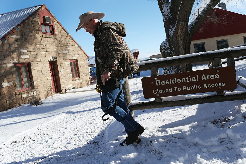 . BURNS, OR - JANUARY 15:  Lavoy Finicum walks through the compound as he and others occupy the Malheur National Wildlife Refuge headquarters  on January 15, 2016 near Burns, Oregon. The armed anti-government militia group continues to occupy the Malheur National Wildlife Headquarters as they protest the jailing of two ranchers for arson.  (Photo by Joe Raedle/Getty Images)