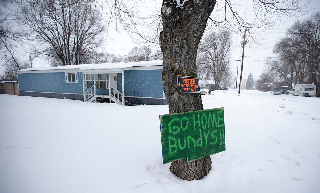. A sign referencing Ammon Bundy and his brother, who are the sons of Nevada rancher Cliven Bundy, hangs on a tree in front of a home Tuesday, Jan. 5, 2016, in Burns, Ore. Ammon Bundy, the leader of a small, armed group that is occupying a remote national wildlife preserve in Oregon said Tuesday that they will go home when a plan is in place to turn over management of federal lands to locals. (AP Photo/Rick Bowmer)