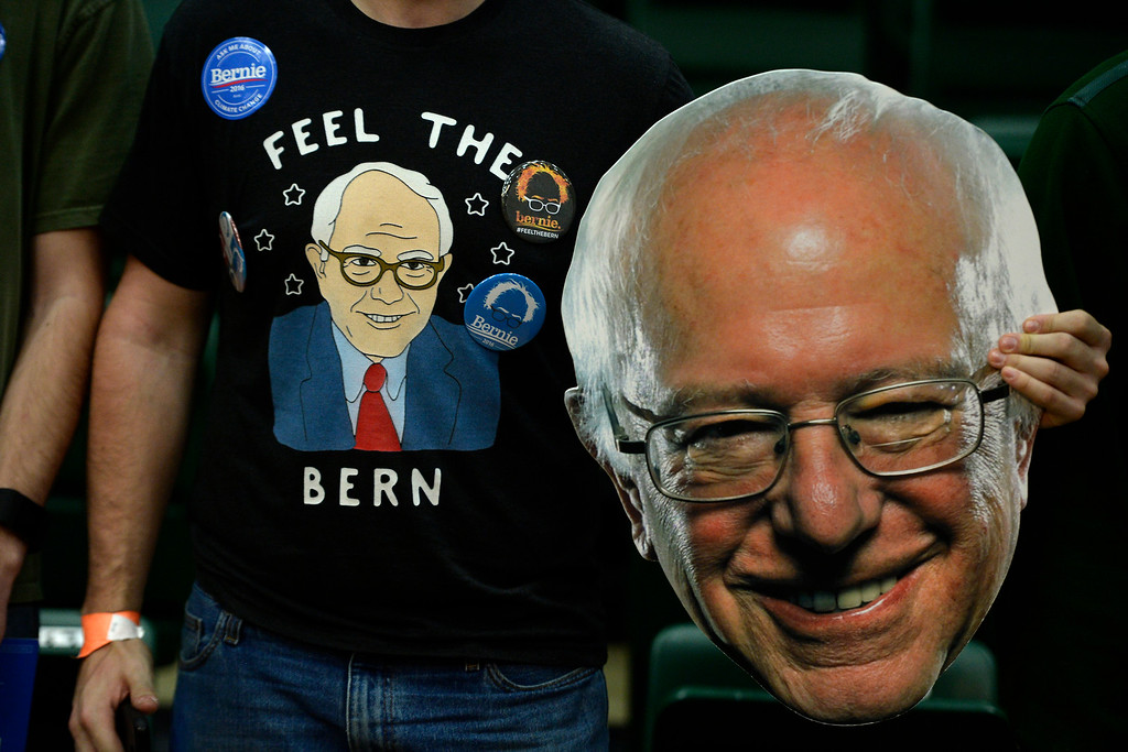 . FORT COLLINS, CO - FEBRUARY 28: A Bernie Sanders supporter rocks gear and holds a fathead during a rally at Colorado State University\'s Moby Arena on Sunday, February 28, 2016. (Photo by AAron Ontiveroz/The Denver Post)