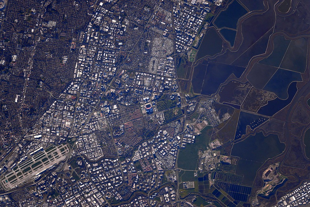 """. This Feb. 7, 2016 photo made available by NASA shows Levi\'s Stadium in Santa Clara, Calif., on the day of the Super Bowl football game. Expedition 46 Commander Scott Kelly who made the photo wrote, \""""Got to see the #SuperBowl in person after all! But at 17,500MPH, it didn\'t last long. #YearInSpace\"""" (Scott Kelly/NASA via AP)"""