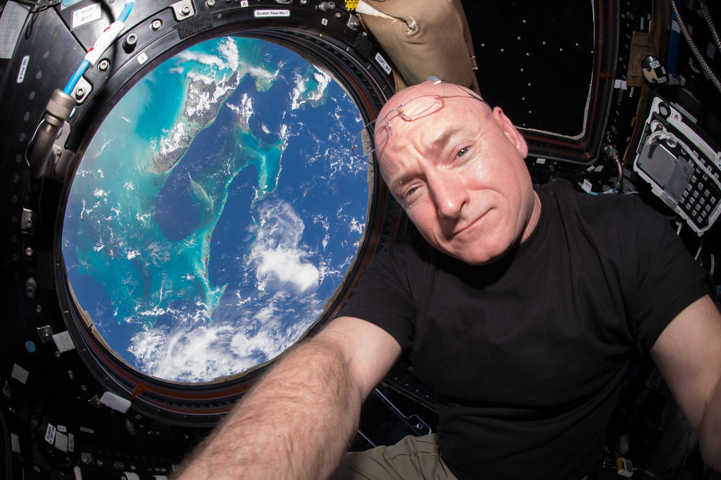 . In this July 12, 2015 photo, Astronaut Scott Kelly takes a photo of himself inside the Cupola, a special module of the International Space Station which provides a 360-degree viewing of the Earth and the station. (Scott Kelly/NASA via AP)