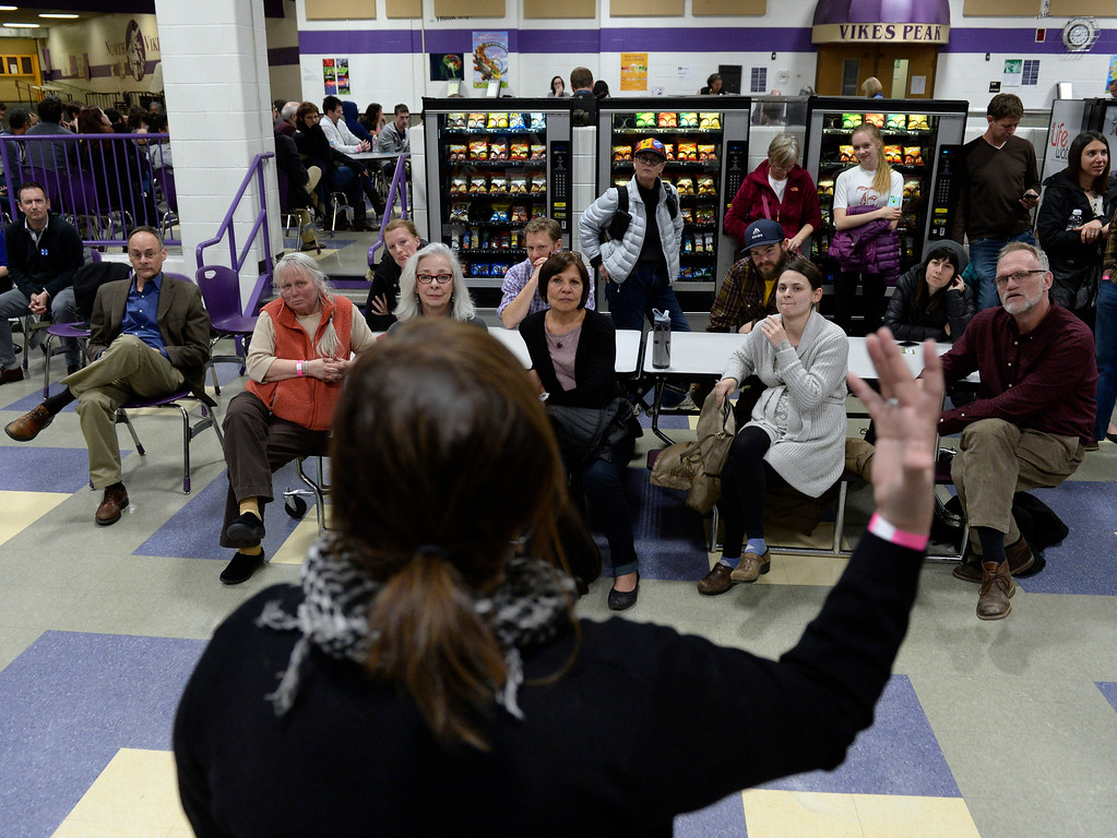 . DENVER, CO - MARCH 1: Linda Garcia speaks on behalf of Hillary Clinton, hoping to sway the undecided voters of Precinct 416. Denver Democrats gather at North High School to participate in the Colorado Democratic Precinct Caucuses. (Photo by Kathryn Scott Osler/The Denver Post)
