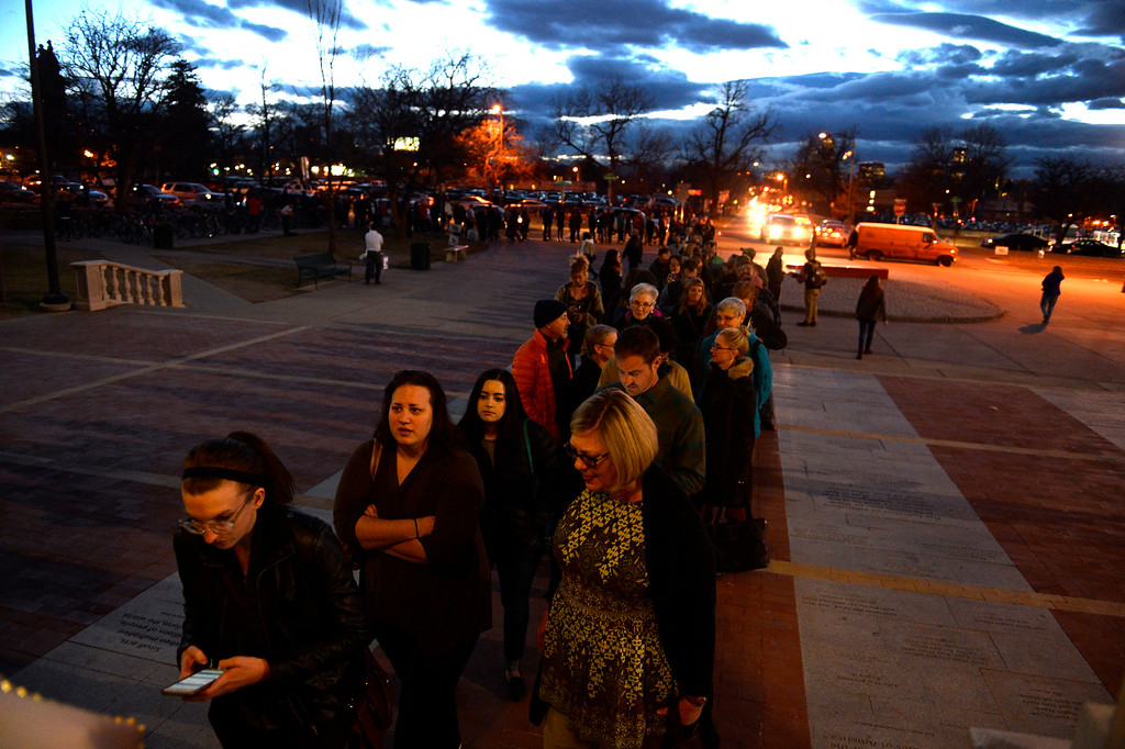 . Hundreds of people wait in line to register for the caucus held at East High school in Denver, Colorado on March 1, 2016. 18 precincts were represented at East High School and thousands of people turned out for the caucus. Organizers had anticipated about 20% of people from their precincts would turn out and many more  actually came. (Photo by Helen H. Richardson/The Denver Post)