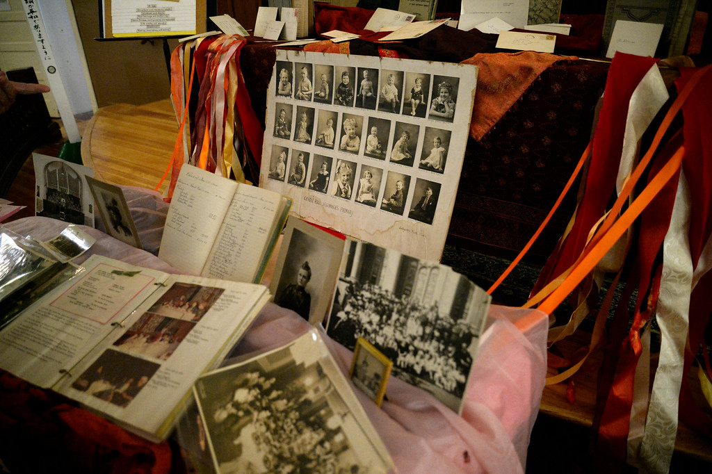. DENVER, CO - APRIL 10: Old photos and other memorabilia line the alter at St. Paul\'s Methodist Church. Rev. Jessica Rooks addresses the congregation April 10, 2016 during the 11am worship at St. Paul\'s Methodist Church. St. Paul\'s Methodist Church a 156-year-old church in an iconic neoclassical building in Uptown, is closing its doors. The congregation make prayer flags during Sunday worship that will be hung along others that have been hung already through out the Church. (Photo By John Leyba/The Denver Post)