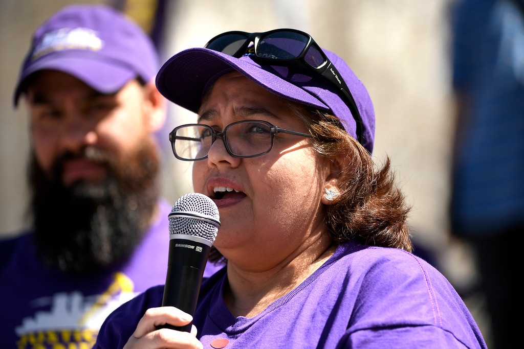 . Denver, CO - ARRIL 14: Susana Renderia of Aurora a janitor for 10 years speaks during low wage earners rally at Civic Center Park�s Veterans Memorial in downtown and they will march past all the buildings where they do their work in Denver. The janitors were joined by local care workers, Fast food, delivery persons and service workers during their Underpaid Fight for $15 march. April 14, 2016 in Denver, CO. (Photo By Joe Amon/The Denver Post)