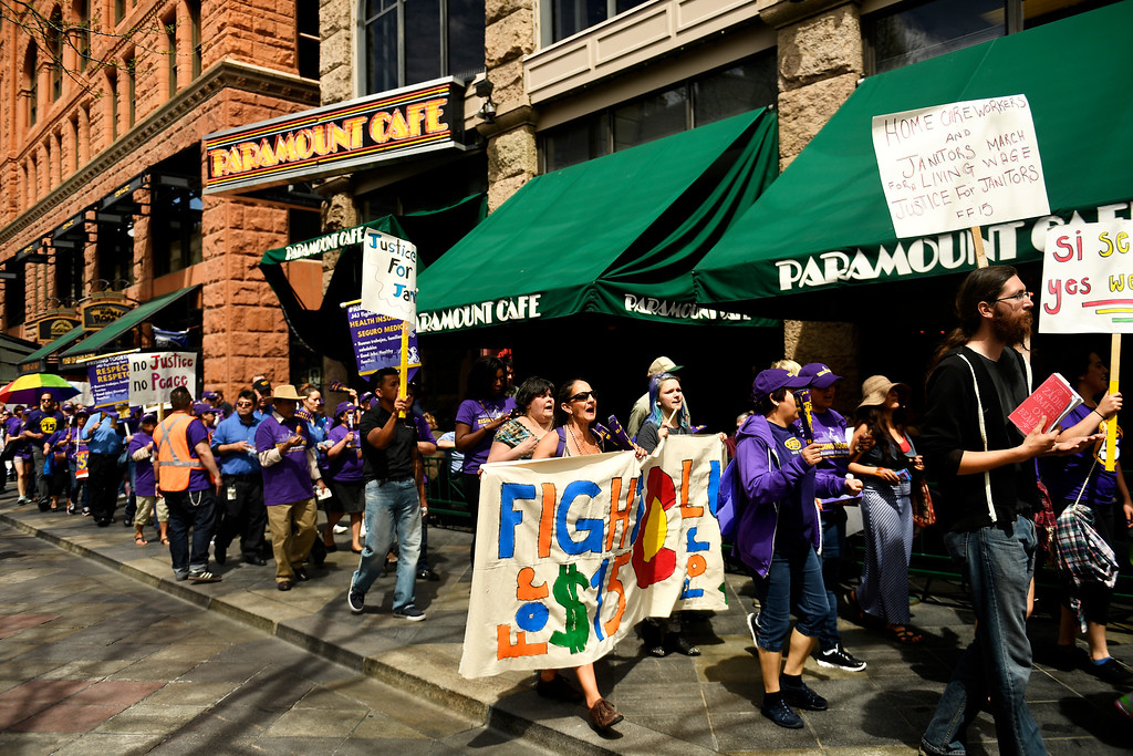 . Denver, CO - ARRIL 14: Denver�s low wage janitors march along 16th street in downtown Denver after their rally at Civic Center Park�s Veterans Memorial. The janitors were joined by local care workers, Fast food, delivery persons and service workers during their  Underpaid Fight for $15 march. April 14, 2016 in Denver, CO. (Photo By Joe Amon/The Denver Post)