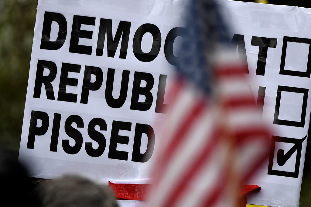 . Denver, CO - ARRIL 15: Colorado Republican voters gather at the state Capitol to protest the delegate selection process when the GOP officials decided not to hold a straw poll March 1st and denied them their vote. April 15, 2016 in Denver, CO. (Photo By Joe Amon/The Denver Post)