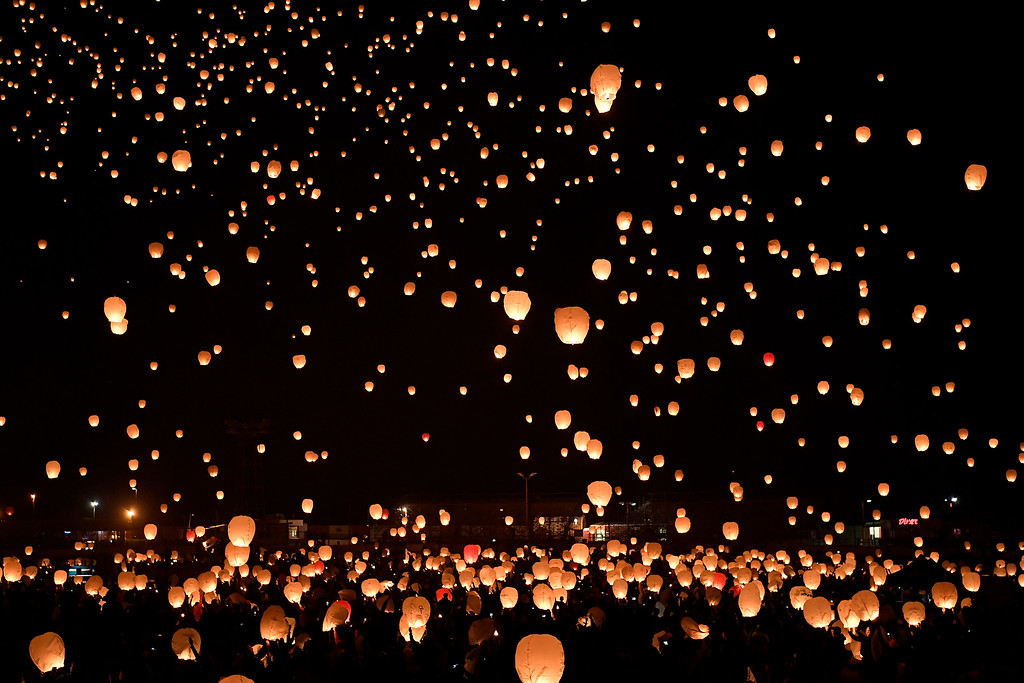 . DACONO, CO - APRIL 24: People light their laters and release them into the night\'s sky during the Lantern Festival in Dacono on Sunday, April 24, 2016. More than 5,000 biodegradable paper lanterns were sent into the sky as part of the celebration. (Photo by AAron Ontiveroz/The Denver Post)