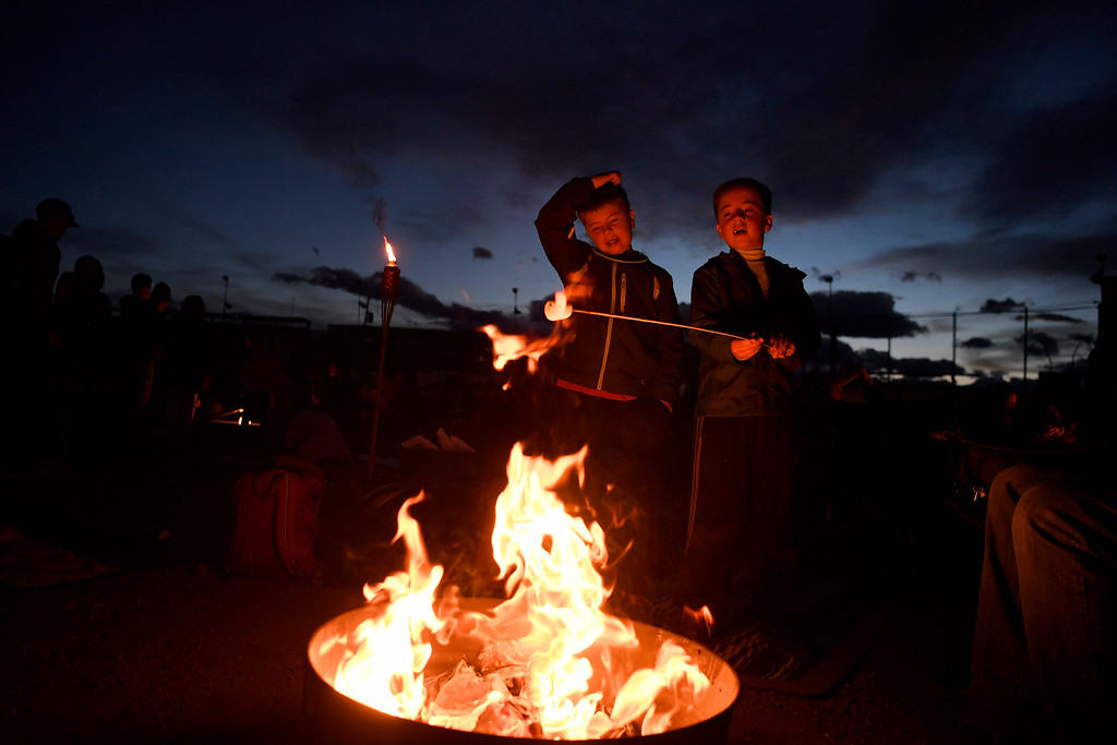 . DACONO, CO - APRIL 24: Wyatt (left) and Seth Carr roast a marshmallow during the Lantern Festival in Dacono on Sunday, April 24, 2016. More than 5,000 biodegradable paper lanterns were sent into the sky as part of the celebration. (Photo by AAron Ontiveroz/The Denver Post)