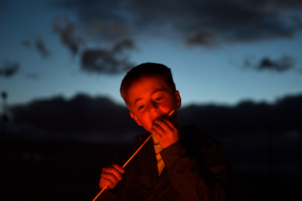 . DACONO, CO - APRIL 24: Seth Carr eats a roasted marshmallow during the Lantern Festival in Dacono on Sunday, April 24, 2016. More than 5,000 biodegradable paper lanterns were sent into the sky as part of the celebration. (Photo by AAron Ontiveroz/The Denver Post)