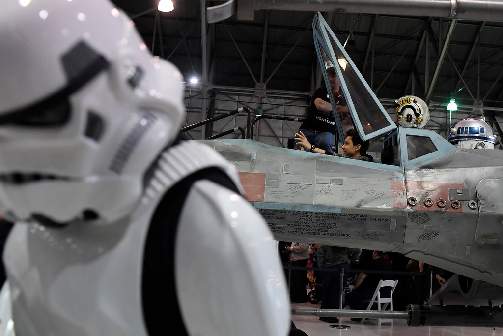 . DENVER, CO - MAY 01: People pose for photos inside on an X-wing Starfighter during a Star Wars themed day at Wings Over the Rockies on Sunday, May 1, 2016. (Photo by AAron Ontiveroz/The Denver Post)