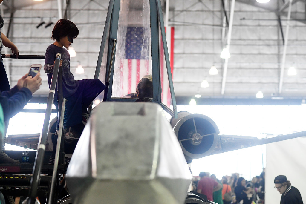 . DENVER, CO - MAY 01: Rhys Pfost, 7, climbs into an X-Wing during a Star Wars themed day at Wings Over the Rockies on Sunday, May 1, 2016. (Photo by AAron Ontiveroz/The Denver Post)