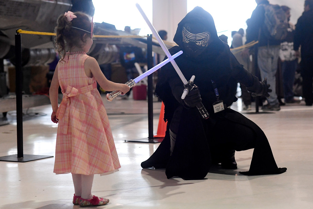 . DENVER, CO - MAY 01: Isabelle Aisch touches light sabers with someone dressed as Kylo Ren during a Star Wars themed day at Wings Over the Rockies on Sunday, May 1, 2016. (Photo by AAron Ontiveroz/The Denver Post)