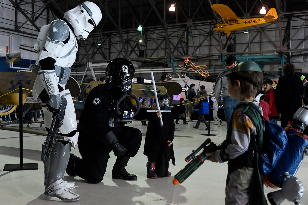 . DENVER, CO - MAY 01: Levi Rosser, dressed as Kilo Ren, poses for a photo with a Stormtrooper and Tie Fighter Pilot during a Star Wars themed day at Wings Over the Rockies on Sunday, May 1, 2016. (Photo by AAron Ontiveroz/The Denver Post)