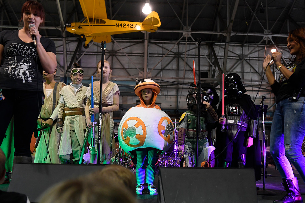 . DENVER, CO - MAY 01: Raquel Bickford, dressed as BB-8, stands with other contestants in the children\'s costume contest before winning the title and a new lightsaber during a Star Wars themed day at Wings Over the Rockies on Sunday, May 1, 2016. (Photo by AAron Ontiveroz/The Denver Post)