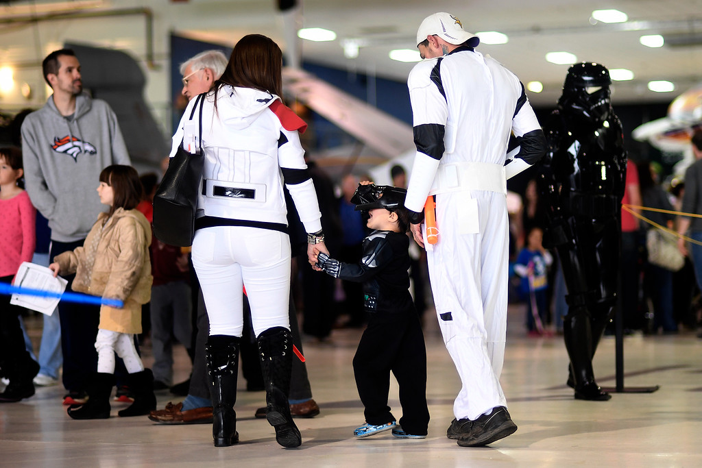 . DENVER, CO - MAY 01: Greg Zecca and Alex Lane walk with Anthony Zecca, 3, during a Star Wars themed day at Wings Over the Rockies on Sunday, May 1, 2016. (Photo by AAron Ontiveroz/The Denver Post)
