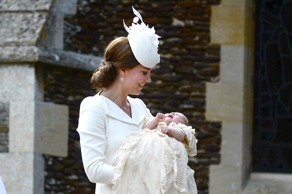 . Catherine, Duchess of Cambridge and Princess Charlotte of Cambridge arrive at the Church of St Mary Magdalene on the Sandringham Estate for the Christening of Princess Charlotte of Cambridge on July 5, 2015 in King\'s Lynn, England.  (Photo by Mary Turner - WPA Pool/Getty Images)