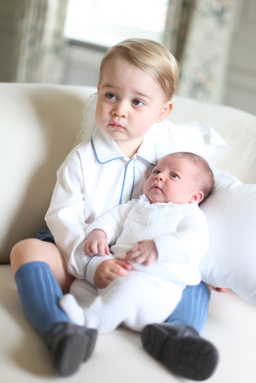 . A handout picture released by Kensington Palace and taken by Britain\'s Catherine, Duchess of Cambridge in May, 2015 shows Prince George of Cambridge (L) and Princess Charlotte of Cambridge (R) at Anmer Hall in Norfolk, eastern England. The Duke of Duchess of Cambridge released four official photographs taken by the Duchess of Prince George and one-month-old Princess Charlotte together at their country retreat in Sandringham.  AFP PHOTO / KENSINGTON PALACE / DUCHESS OF CAMBRIDGE