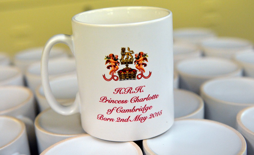 . Mugs celebrating the birth of Princess Charlotte of Cambridge are pictured at the Prince William Pottery in Liverpool, north-west England, on May 6, 2015. Queen Elizabeth II met her new great-granddaughter for the first time on Tuesday, visiting the three-day-old and her parents Prince William and Kate at Kensington Palace. Princess Charlotte Elizabeth Diana, who was born on Saturday, was named in tribute to the 89-year-old monarch as well as William\'s mother Diana, who died in a car crash in 1997. AFP PHOTO/PAUL ELLIS