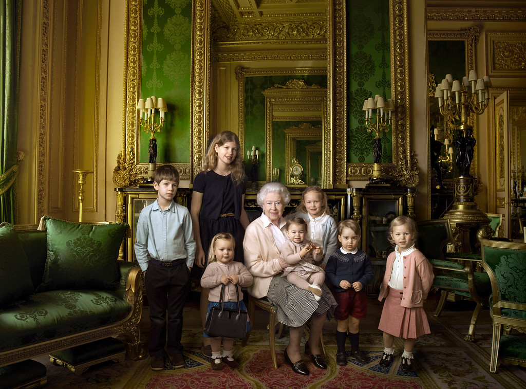 . This official photograph, released by Buckingham Palace on Wednesday April 20, 2016,  to mark her 90th birthday, shows Queen Elizabeth II with her five great-grandchildren and her two youngest grandchildren in the Green Drawing Room, part of Windsor Castle\'s semi-State apartments in Windsor England. The children are: James, Viscount Severn, 8-years-old, left, and Lady Louise, 12-years-old, second left, the children of The Earl and Countess of Wessex;  Mia Tindall, holding The Queen\'s handbag, the two year-old-daughter of Zara and Mike Tindall; Savannah  5-years-old, third right, and Isla Phillips, 3-years-old, right, daughters of The Queen\'s eldest grandson Peter Phillips and his wife Autumn; Prince George, 2-years-old, second right, and in The Queen\'s arms and in the tradition of Royal portraiture, the youngest great-grandchild, Princess Charlotte, 11-months-old,  children of Prince William and Kate Duchess of Cambridge.  (© 2016 Annie Leibovitz  via AP)