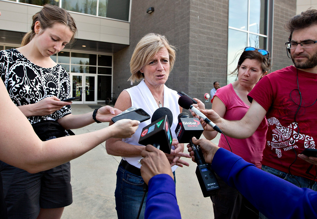 . Alberta Premier Rachel Notley speaks with media about the wildfires in Fort McMurray, Alberta, Wednesday, May 4, 2016. The raging wildfire emptied Canada\'s main oil sands city, destroying entire neighborhoods of Fort McMurray, where officials warned Wednesday that all efforts to suppress the fire have failed.  (Jason Franson /The Canadian Press via AP)