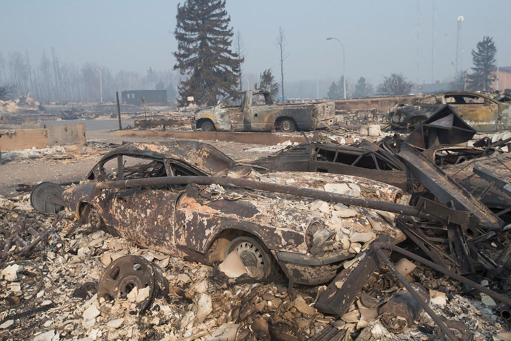 . The remains of a classic Triumph GT6 sit in a residential neighborhood destroyed by a wildfire on May 6, 2016 in Fort McMurray, Alberta, Canada Wildfires, which are still burning out of control, have forced the evacuation of more than 80,000 residents from the town.  (Photo by Scott Olson/Getty Images)