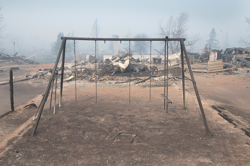 . A swing set with the swings burned away sits in a residential neighborhood destroyed by a wildfire on May 6, 2016 in Fort McMurray, Alberta, Canada Wildfires, which are still burning out of control, have forced the evacuation of more than 80,000 residents from the town.  (Photo by Scott Olson/Getty Images)