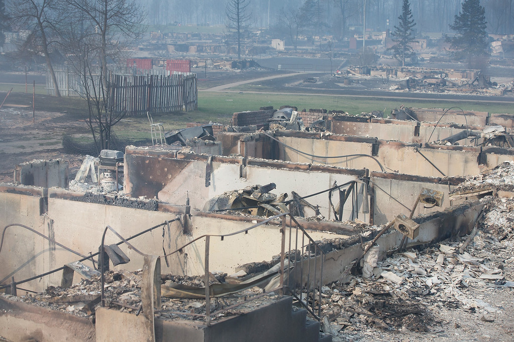 . Home foundations are all that remain in a residential neighborhood destroyed by a wildfire on May 6, 2016 in Fort McMurray, Alberta, Canada Wildfires, which are still burning out of control, have forced the evacuation of more than 80,000 residents from the town.  (Photo by Scott Olson/Getty Images)