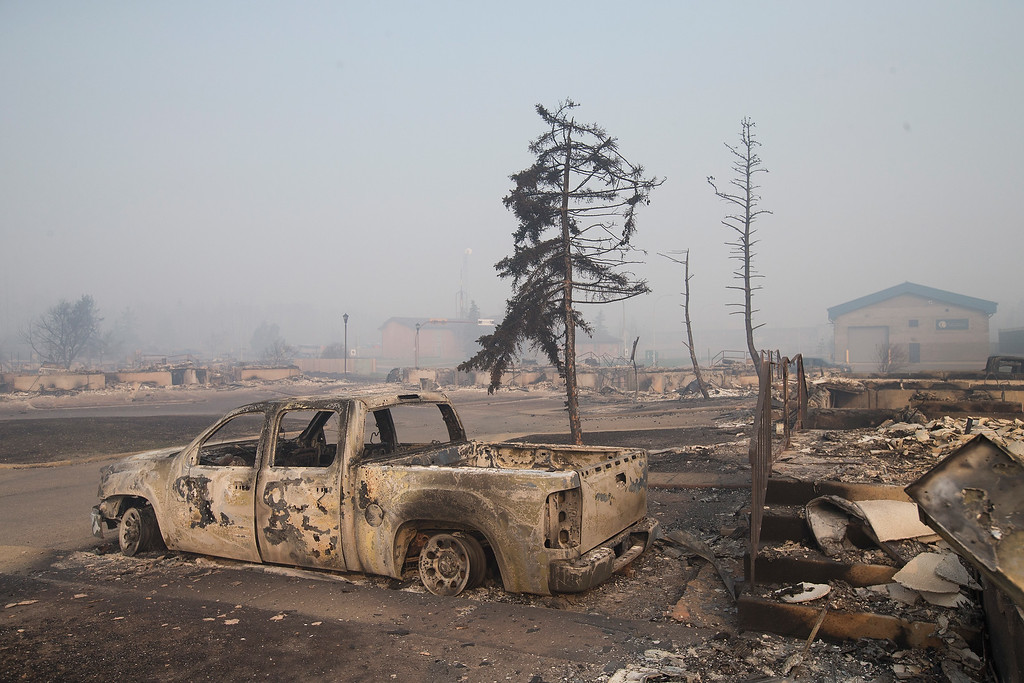 . Home foundations and shells of vehicles are nearly all that remain in a residential neighborhood destroyed by a wildfire on May 6, 2016 in Fort McMurray, Alberta, Canada Wildfires, which are still burning out of control, have forced the evacuation of more than 80,000 residents from the town.  (Photo by Scott Olson/Getty Images)